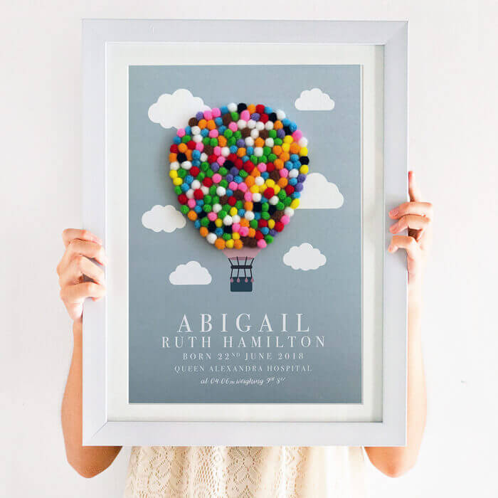 This Personalised Hot Air Balloon Pom Pom Nursery Print is totally unique. Created using multi coloured pom poms, this print will brighten any nursery or play room.