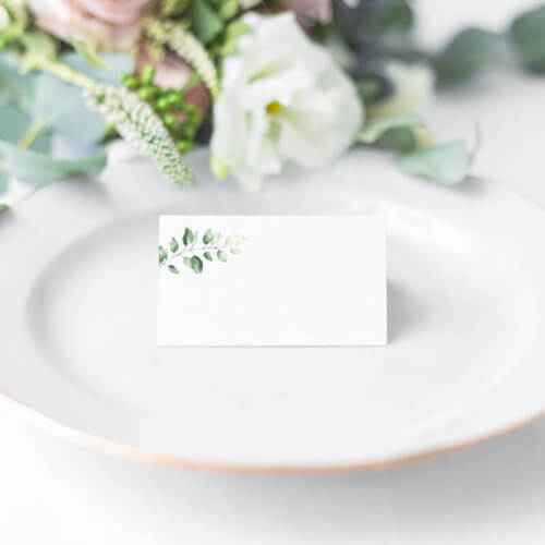 Green foliage table place name signs front